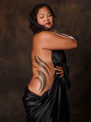 Elicia Santo Tomas showcases her traditional Samoan tattoos that was hand crafted by Independent State of Samoa master tattoo artist Su'a Sulu'ape Peter.