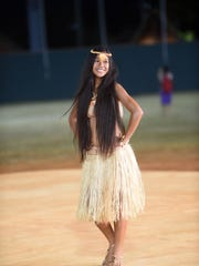 Models display traditional attire from Guam at the