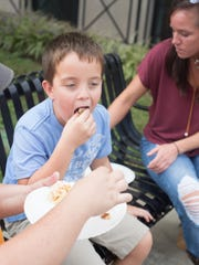 Caiden Gregory enjoys the food and fellowship during