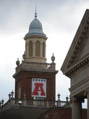 A banner with the letter grade A hangs on the bell tower at Richmond High School to promote the school's state accountability grade in this file photo.