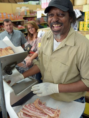 """Tommy Lee Kelly, who slices bacon every day at the Williams Brothers store in Philadelphia, gives himself the same pep talk driving to work each day: """"Make people smile. The customer is always right. Try not to take complaints personal."""""""