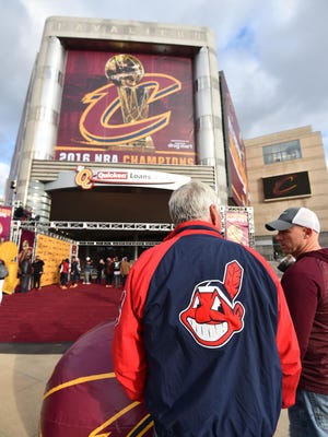Indians fans Tim Toot stands outside of Quicken Loans Arena home of the Cleveland Cavaliers.