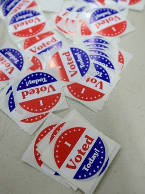 Stickers await voters Saturday, Oct. 29, 2016 at the Kuhlman Center at the Wayne County Fairgrounds in Richmond.