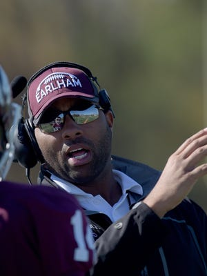 Earlham College football coach Nick Johnson leads the Quakers Saturday, Nov. 5, 2016 during a football game against Bluffton at Earlham College in Richmond.