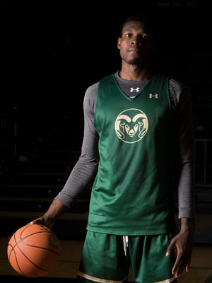 CSU forward Emmanuel Omogbo poses for a portrait on Friday at Moby Arena. Omogbo is dedicating this season to everyone who helped him through the loss of his parents.