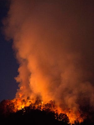 A wildfire in Blount County on Thursday, November 17, 2016 near Walland Elementary School has burned 20-80 acres of land and could spread to 200 acres.