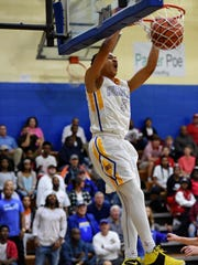 Wren's Trey McGowens slams in a dunk during the first half. Wren hosted Greenville in varsity basketball Friday, Jan. 13, 2017.