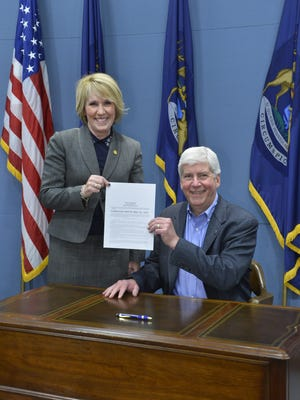 State Rep. Laura Cox, R-Livonia, with Gov. Rick Snyder.