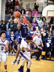Thurston's Malik Hill goes in for the shot in Tuesday's game at Redford Union.