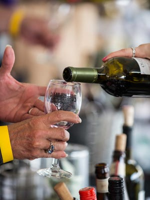 Wine being poured at a previous Newburgh Wine and Jazz Festival.