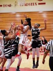 Fighting for a rebound against several Wayne Memorial
