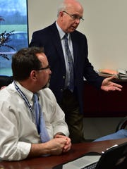 Ridgeland High School principal Tim Dowdy (seated) listens while Madison County Superintendent Ronnie McGehee talks to reporter Billy Watkins (off camera) about measures being taken to enhance and maintain student safety.