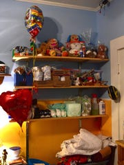 Shelving in Robbie Elam's bedroom holds medical supplies,
