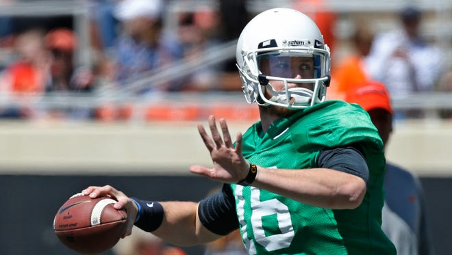 Richard Lagow, shown here in 2014 with Oklahoma State, will compete for IU's starting QB job this spring.