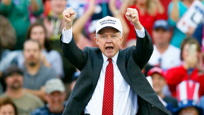 Attorney General-designate, Sen. Jeff Sessions, R-Ala., cheers on the crowd during a President-elect Donald Trump rally at Ladd–Peebles Stadium, Saturday in Mobile.