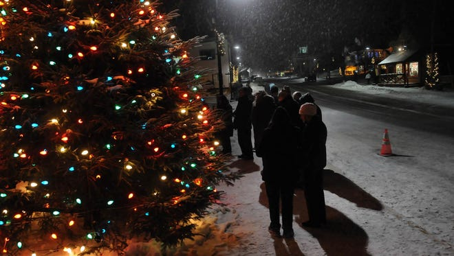 Visitors gather 'round the Christmas tree at Harbor View Park at last year's Holly Days in Egg Harbor.