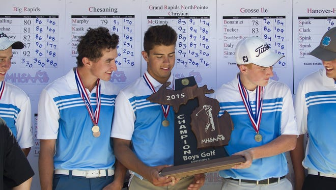 Members of the Lansing Catholic Golf team accept their 2015 Div. 3 Championship trophy June 6, 2015, at Forest Akers West in East Lansing. The Cougars will look to capture their fourth consecutive state title in 2016.