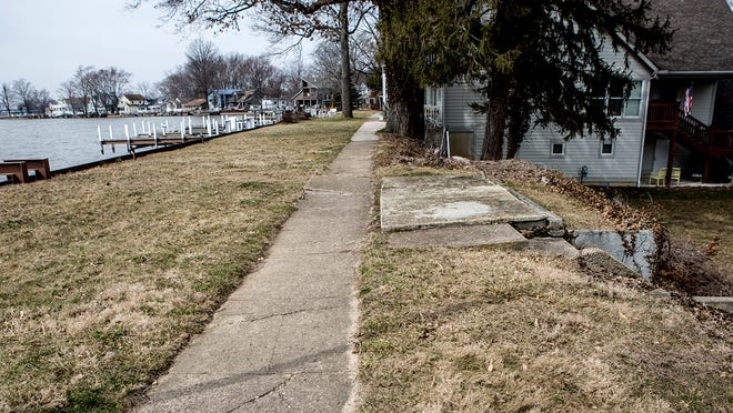 This is a view along Buckeye Lake's north shore, where the homes face North Bank Road in Millersport. Sidewalks have been built atop the earthen dam and many foundations for homes, including the remains of one since demolished, are dug into the dam, potentially compromising its structure.