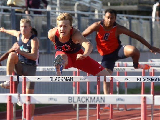 Oakland's Brady Fry wins the 110 meter hurdles on Wednesday,
