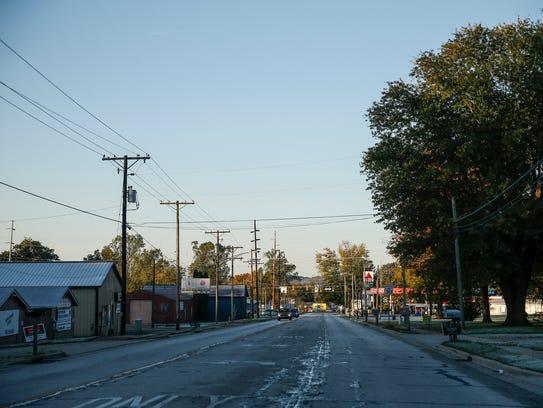 The sun rises as motorists make their way down E. Morgan