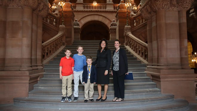 Sen. Sue Serino presented Chase Piotrowski, age 7, with the NYS Liberty Medal in Albany. Chase was joined by his mom, Tara, and his brothers, Mike and Jake.