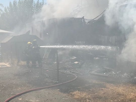 Crews battle a fire that destroyed a mobile home in