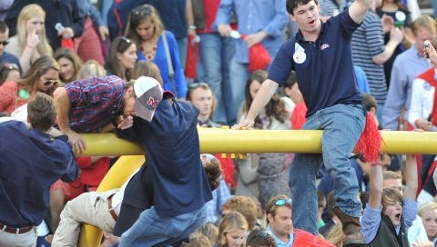 Ole Miss fans celebrate Saturday's victory over Alabama in Oxford. The Rebels won 23-17.