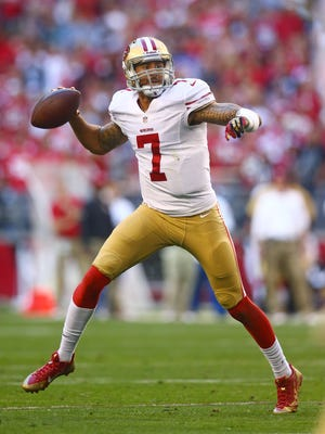 San Francisco 49ers quarterback Colin Kaepernick (7) throws a pass in the second quarter against the Arizons Cardinals at University of Phoenix Stadium.