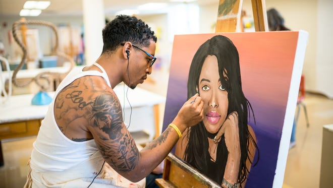Xavier Ayers participates in an art class at Western New Mexico University
