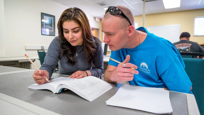 Pictured are Ruth Moyer and Joshua Odom during a study session in Watts Hall where Adult Education Services offices are located.