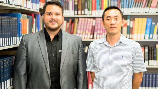 From left, are Adrian Barbosa and Dr. Takahiro Sato. The duo worked together during an exchange earlier at Western New Mexico University.