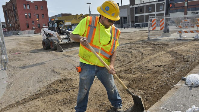 Hardrives Lead Foreman Travis Iverson levels Fifth Avenue North on Monday where it connects with First Street North where a parking ramp is planned.