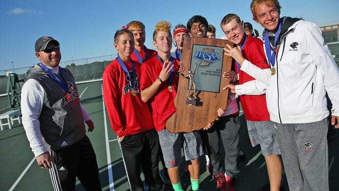 North Central head boys tennis coach Dan Brunette, left, stands with his team after they won the state championship of the boys tennis state finals at North Central High School, Saturday, October 17, 2015.  North Central boys came away with the championship, and Park Tudor boys tennis team was state runner-up.
