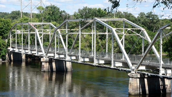 This bridge over the Mississippi River in Sartell hasn't carried traffic in decades, but still supports utilities and power lines.