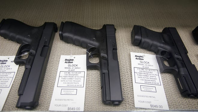 Glocks for sale are displayed at Double Action Indoor Shooting Center and Gun Shop on Friday, June 9, 2017 in Warren.