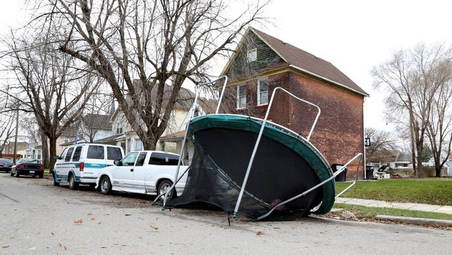 A trampoline clearly blew onto 18th street in southwest Detroit as winds picked up in the Detroit metropolitan area on Monday, November 24, 2014.High wind alert is in effect until 10pm