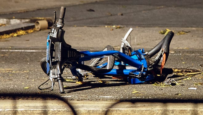 A bicycle lies on a bike path at the crime scene where a motorist earlier Tuesday drove onto the path near the World Trade Center memorial, striking and killing several people, Wednesday, Nov. 1, 2017, in New York.