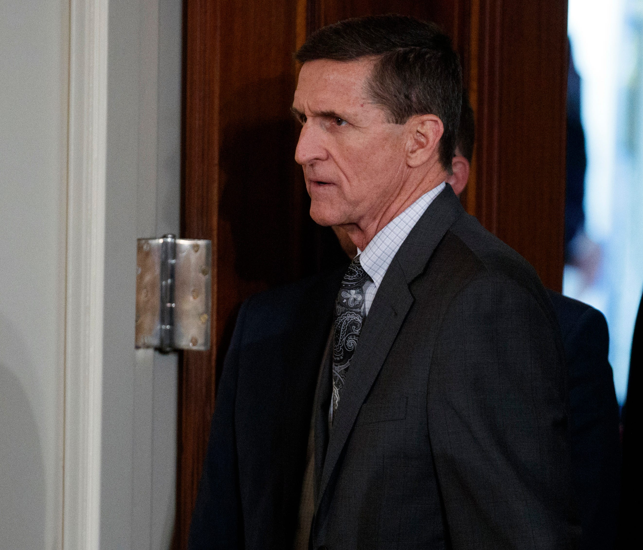 FILE - In this Feb. 13, 2017 file photo, Mike Flynn arrives for a news conference in the East Room of the White House in Washington. Targeted in widening investigations of his foreign entanglements, President Donald Trump's former national security a