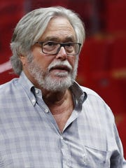 In this March 13, 2019 photo, Micky Arison, Miami Heat managing general partner and chairman of Carnival Cruise Line, walks courtside before the start of an NBA basketball game in Miami. A federal judge has threatened to temporarily block Carnival Corp. from docking cruise ships at ports in the United States as punishment for a possible probation violation.
