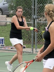 SP 0820 Tennis_2.jpg SPASH's Jaide Barber returns a backhanded shot while her partner  Juliet Champion watches at the net against Appleton East in the #1 doubles match at the SPASH Tennis Invite Wednesday in Stevens Point. Photo by Thomas Kujawski/FOR STEVENS POINT JOURNAL MEDIA