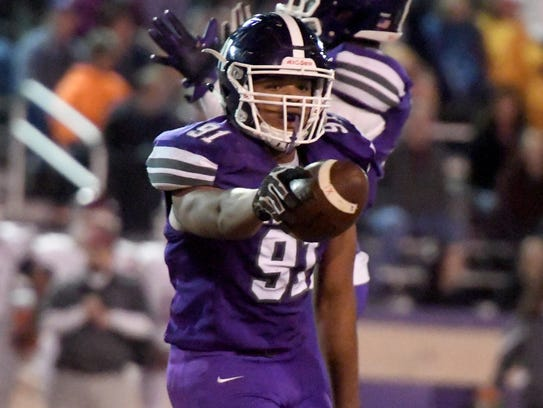 Haywood's Jerwin Young points to his teammates after