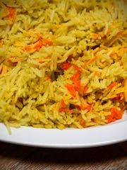 A large side of seasoned basmati rice is popular at