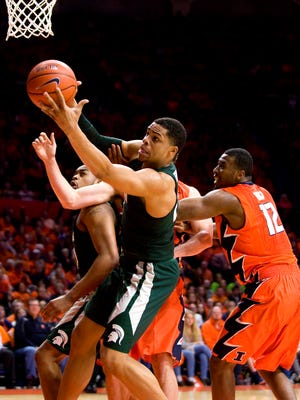 Mar 1, 2017; Champaign, IL, USA; Michigan State Spartans forward Miles Bridges grabs a rebound during the first half against the Illinois Fighting Illini at State Farm Center.
