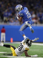 Lions wide receiver Golden Tate makes a catch against the Steelers' Sean Davis before fumbling it away during the fourth quarter of the Lions' 20-15 loss on Sunday, Oct. 29, 2017, at Ford Field.