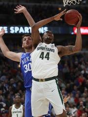 Michigan State's Nick Ward scores against Duke's Antonio