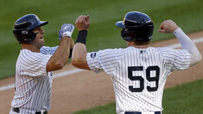 New York Yankees' Brett Gardner is congratulated by Luke Voit (59) after hitting a two-run home run during the first inning of the first game of a doubleheader against the Baltimore Orioles on Friday.