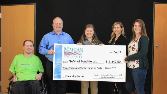 Marian University's Student Social Work Association, or SSWA, donated $3,347.50 to the Fond du Lac Chapter of the National Alliance on Mental Illness, or NAMI. Pictured are, from left: Tony Sabel, NAMI of Fond du Lac coordinator; Dale Hans, NAMI Fond du Lac Board president; Taylor Bufton, SSWA Executive Board treasurer; Sarah Fields, SSWA Executive Board vice president; and Alyson Sanders, SSWA Executive Board president.