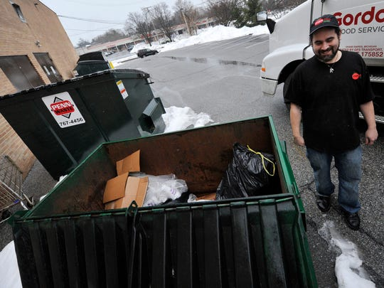 Pedro Febres, the manager of Mexitaly Brick Oven Brewhouse, talks about the dumpster next to the restaurant where a suspect was hiding after allegedly stealing a police car in Springettsbury Township.