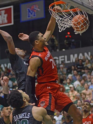 Cincinnati forward, Kyle Washington, right, dunks the ball against Tulane guard, Melvin Frazier, left, in the first half of an NCAA college basketball game in New Orleans, La., on Thursday, March 1, 2018.