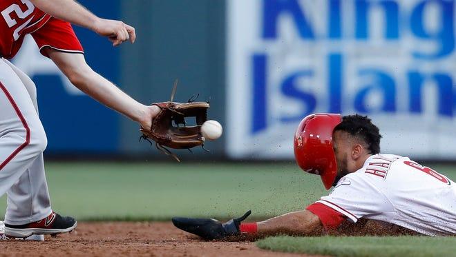 Cincinnati Reds' Billy Hamilton, right, steals second against Washington Nationals second baseman Daniel Murphy during the third inning of a baseball game, Saturday, July 15, 2017, in Cincinnati.
